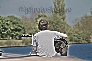 guitarist on boat