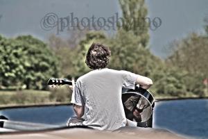 guitarist on boat