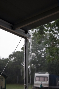 Water pouring over the edge of the awning